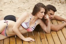 Free Young Couple On Sundeck Stock Photos - 17141233