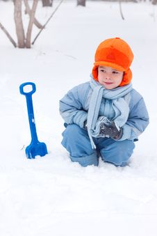 Little Boy Playing, Digs Snow Stock Photos