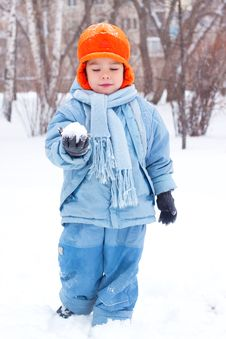 Free Little Boy Playing Snowballs Stock Image - 17142421