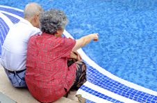 Free A Happy Senior Couple Sitting Beside A Pool Royalty Free Stock Photos - 17147698