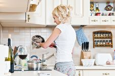 Free Woman Working In The Kitchen Royalty Free Stock Photos - 17148788