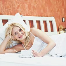 Free Portrait Of Beautiful Young Woman With Cup On Bed Royalty Free Stock Photo - 17148885