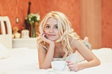 Free Portrait Of Beautiful Young Woman With Cup On Bed Royalty Free Stock Photos - 17148908