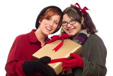 Two Pretty Girlfriends Holding A Holiday Gift Stock Images