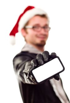 Man With Santa Hat Holding Out Blank Cell Phone Royalty Free Stock Photos