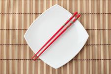 Free Red Chopsticks And White Dish On A Bamboo Napkin Stock Photos - 17149533