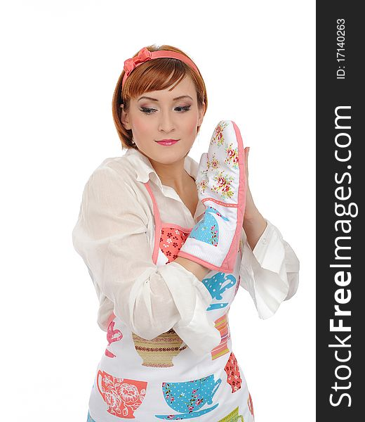 Beautiful cooking woman in apron and kitchen glove