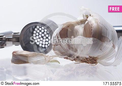 Free Garlic And Garlic Press Royalty Free Stock Photo - 17155575