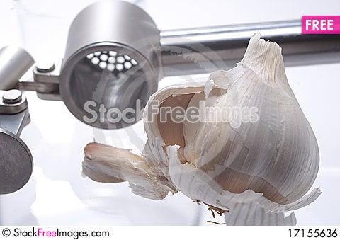 Free Garlic And Garlic Press Royalty Free Stock Image - 17155636