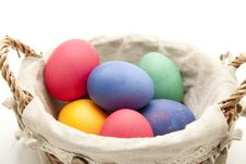 Colored Eggs In The Basket Stock Photo