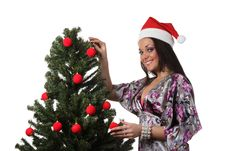 Free Woman Decorate A Christmas Tree Stock Images - 17151784