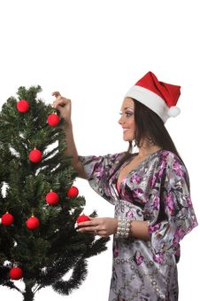 Free Woman Decorate A Christmas Tree Royalty Free Stock Photo - 17151785