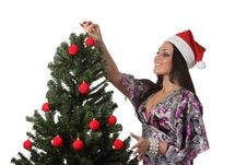 Free Woman Decorate A Christmas Tree Royalty Free Stock Image - 17151786