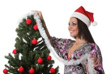 Free Woman Decorate A Christmas Tree Stock Image - 17151791
