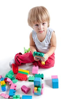 Little Boy Playing With Colorful Blocks Royalty Free Stock Photos