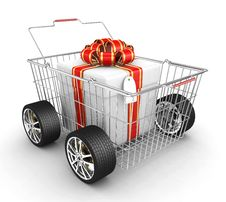 Free Gift Box, Shopping Basket And Wheels Stock Photography - 17157462