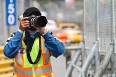Free A Man Takes A Photograph Stock Images - 17159404
