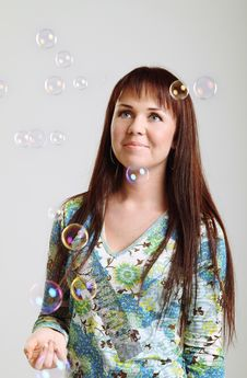 Brunette Girl Looking At Soap  Bubbles Royalty Free Stock Photo