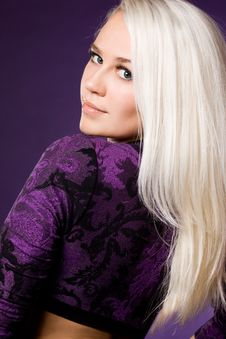 Woman On Violet Background Stock Photography