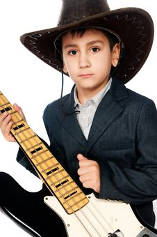 Free Boy In A Cowboy Hat And Guitar Stock Photo - 17159850
