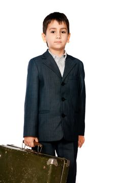 Free Boy In A Suit And Carrying A Suitcase Royalty Free Stock Image - 17159896
