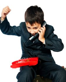 Young Boy Talking On The Phone Royalty Free Stock Photography