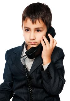Young Boy Talking On The Phone Royalty Free Stock Images