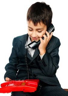 Free Young Boy Talking On The Phone Royalty Free Stock Photography - 17159957