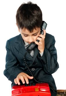 Free Young Boy Talking On The Phone Stock Images - 17159964
