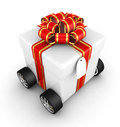Free Gift Box, Shopping Basket And Wheels Royalty Free Stock Photos - 17160598