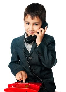 Free Young Boy Talking On The Phone Stock Photography - 17160012