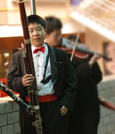 Free Bassoon Boy In Concert Royalty Free Stock Photography - 17161717