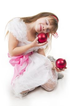 Girl Plays With Christmas Red Ball Royalty Free Stock Images