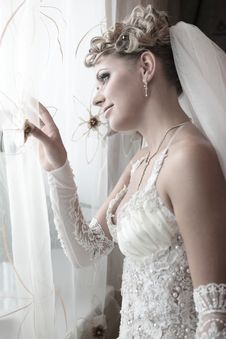 The Beautiful Bride Looks Out Of The Window