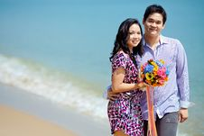 Free Attractive Couple Standing Together On The Beach Royalty Free Stock Photos - 17163168