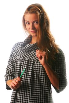 Free Blonde Girl In A Checkered Dress With Pen Royalty Free Stock Photos - 17164368