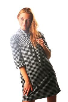 Free The Blonde Girl In A Checkered Dress On A White Royalty Free Stock Image - 17164756