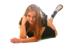 The Blonde In A Black Dress Lays On A White Stock Photo