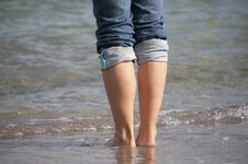 Girl Standing In Water Stock Photography