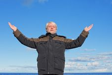 Free Middle-aged Man On Blue Sky Of The Background. Royalty Free Stock Photos - 17167638