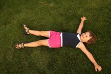 Young Girl Lie On Green Grass Royalty Free Stock Photo