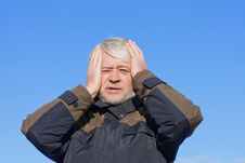 Portrait Of Mature Man On Blue Sky Of Background Royalty Free Stock Images