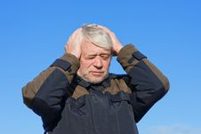 Portrait Of Mature Man On Blue Sky Of  Background. Stock Images