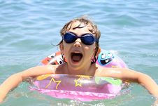 Free A Small Child Swims In The Sea Royalty Free Stock Photos - 17167798