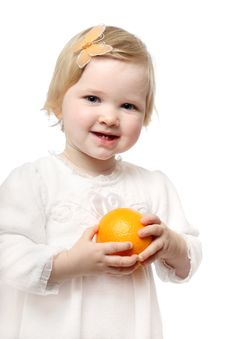 Free Smiling Baby With Orange Stock Photography - 17168052