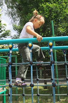 Free A Girl Walking On The Ladder At The Playground Stock Image - 17168081
