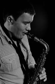 Free Young Handsome Man Playing Music On Saxophone Royalty Free Stock Photography - 17168087