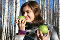 Free Young Girl With Two Green Apples In The Birch Wood Stock Image - 17174491