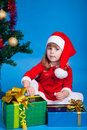 Free Pretty Baby Miss Santa Sitting Near Christmas Tree Stock Images - 17175754