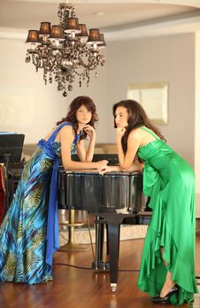 Free Two Beautiful Young Women At A Piano Stock Photos - 17171323
